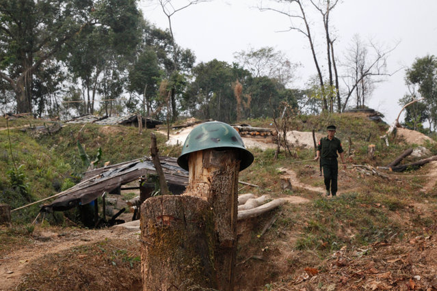In this March 17, 2018 photo, a Kachin Independence Army rebel walks in frontline at Hpalap mountain controlled by the Kachin rebels in northern Kachin state, Myanmar. The Kachin Independence Army along with other ethnic armed groups have been fighting against Myanmar army for greater autonomy. The fighting between the Kachin army and the government military resumed in 2011, ending the 17 years of ceasefire agreement. (Photo by Esther Htusan/AP Photo)