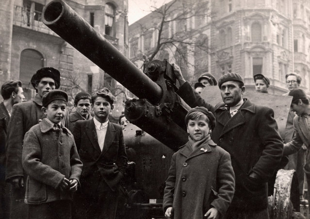 Fighters stand next to a Soviet tank on the streets of Budapest at the time of the uprising against the Soviet-supported Hungarian communist regime in 1956. The picture was taken in the period between October 23 and November 4, 1956. (Photo by Laszlo Almasi/Reuters)
