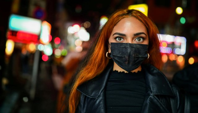 A female tourist wears a protective face mask on the street, following an outbreak of the coronavirus disease (COVID-19), in Tokyo, Japan on March 10, 2020. (Photo by Hannibal Hanschke/Reuters)