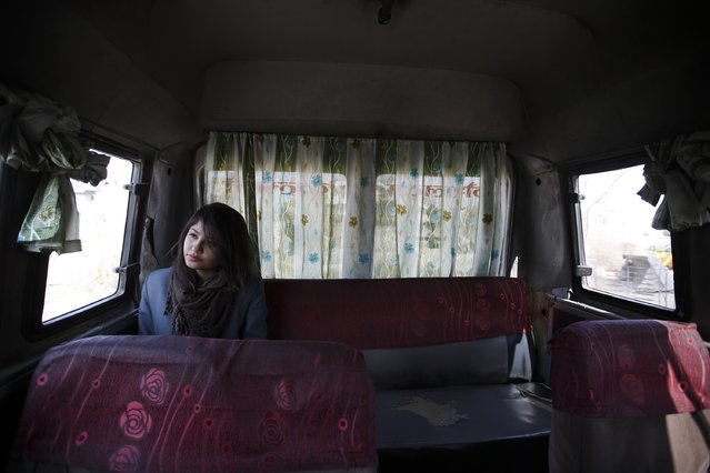 A woman rides a women-only bus as she returns from her college in Kathmandu January 6, 2015. Nepal's capital Kathmandu has introduced women-only buses in an attempt to reduce sexual harassment and groping on public transport, a senior government official said on Monday. The initiative will start with four 16-seater buses which will ply a popular east-west route across the city during peak morning and evening hours. (Photo by Navesh Chitrakar/Reuters)