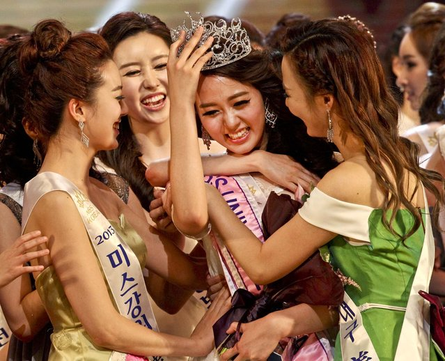 Winner Yoo Ye-bin, a 21-year-old college student,  is congratulated by contestants during the 2013 Miss Korea Contest in Seoul, on June 4, 2013. Yoo will represent South Korea for this year's Miss Universe beauty pageant. (Photo by Ahn Young-joon/Associated Press)