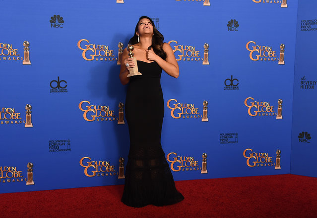 "Gina Rodriguez poses in the press room with the award for best actress in a television series – musical or comedy for ""Jane the Virgin"" at the 72nd annual Golden Globe Awards at the Beverly Hilton Hotel on Sunday, January 11, 2015, in Beverly Hills, Calif. (Photo by Jordan Strauss/Invision/AP Photo)"