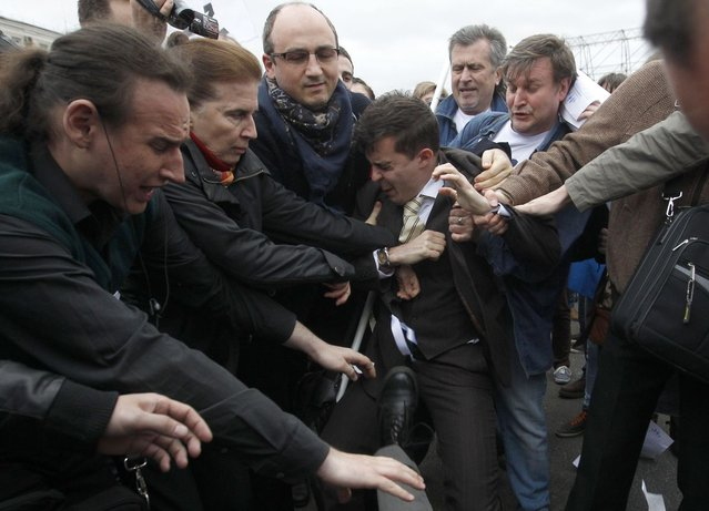 A gay rights activist (C) scuffles with Orthodox Christian activists during a protest rally in Moscow, May 6, 2013. (Photo by Maxim Shemetov/Reuters)