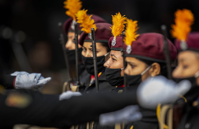 Assam police women commandos wearing masks as precaution against the coronavirus march during India's Republic Day celebrations in Gauhati, India, Tuesday, January 26, 2021. (Photo by Anupam Nath/AP Photo)