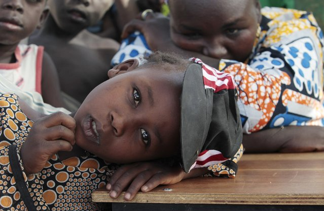 A girl displaced as a result of Boko Haram attack in the northeast region of Nigeria, rests her head on a desk at Maikohi secondary school camp for internally displaced persons (IDP) in Yola, Adamawa State January 13, 2015. (Photo by Afolabi Sotunde/Reuters)