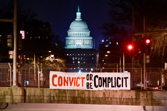 "A banner reading, ""Convict or be complicit"" is hung over a bridge in view of the U.S. Capitol on the first day of the Senate impeachment trial against former President Donald Trump in Washington, U.S., February 9, 2021. (Photo by Erin Scott/Reuters)"