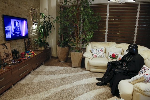 Darth Mykolaiovych Vader, who is dressed as the 'Star Wars' character Darth Vader, poses for a picture as he watches television at his apartments in Odessa, Ukraine, December 2, 2015. (Photo by Valentyn Ogirenko/Reuters)