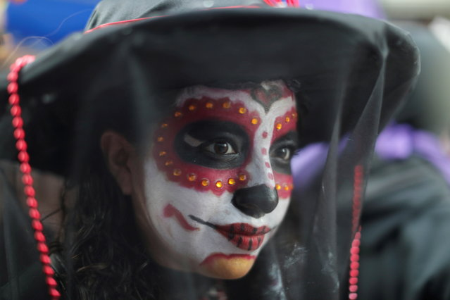 A woman looks on as she takes part in a protest on the Day of the Dead against gender violence and femicide, in Mexico City, Mexico, November 2, 2020. (Photo by Raquel Cunha/Reuters)