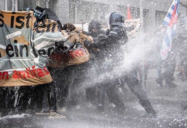 """The police use a water cannon on the opponents of the """"lateral thinking"""" demonstration in the Frankfurt/Main city centre on November 14, 2020 under the motto """"No lockdown for Bembeltown!"""". (Photo by Boris Roessler/dpa/Pacific Coast News)"""