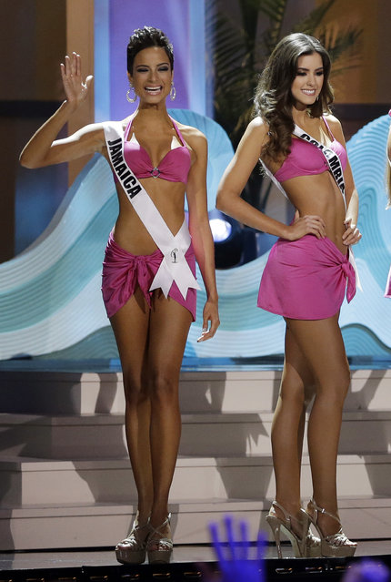 Miss Jamaica Kaci Fennell waves in her swimsuit during the Miss Universe pageant in Miami, Sunday, January 25, 2015. (Photo by Wilfredo Lee/AP Photo)