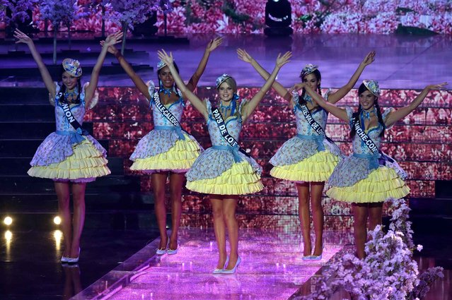 Miss France contestants parade during the Miss France 2016 beauty pageant, on December 19, 2015 in Lille, northern France. (Photo by Philippe Huguen/AFP Photo)
