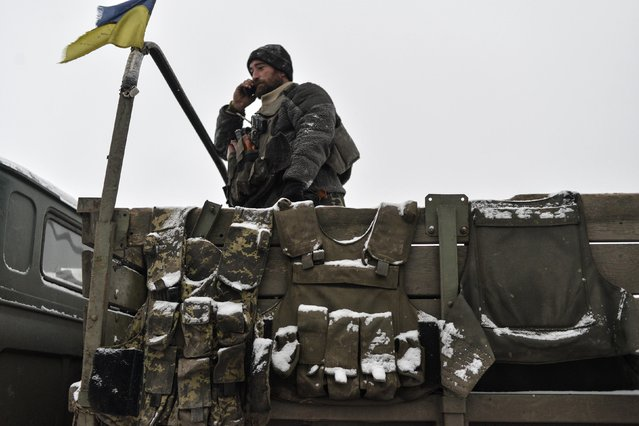 A Ukrainian serviseman talks on his mobile phone as he stands in a military truck outside Debaltseve, eastern Ukraine February 10, 2015. (Photo by Alexei Chernyshev/Reuters)