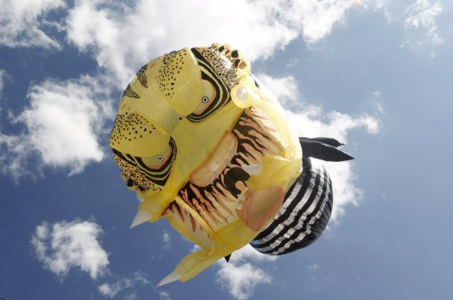 "A balloon depicting movie character ""Predator"" is seen in the sky at the 15th Solar Balloon Festival in Envigado, Colombia December 31, 2015. (Photo by Fredy Builes/Reuters)"