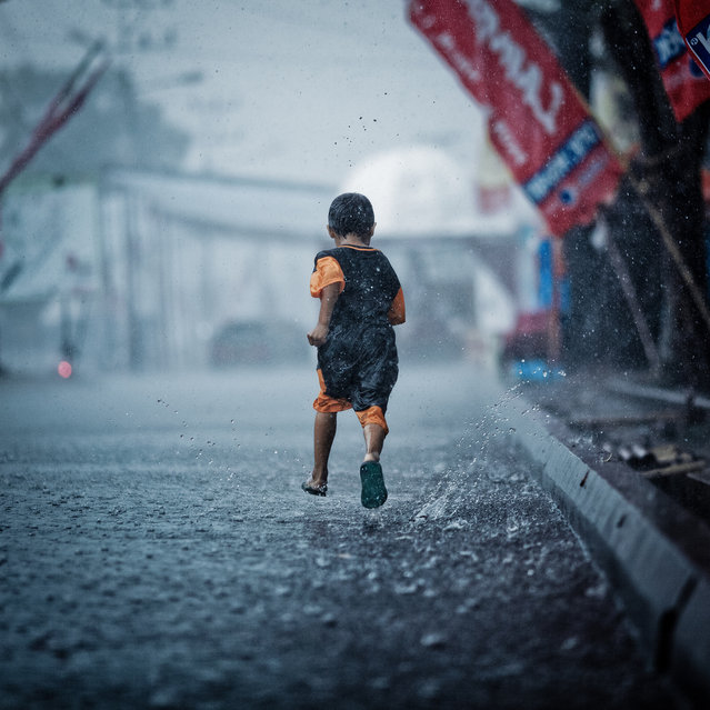"""The boy who leapt through rain"". (Photo by Rifat Attamimi)"