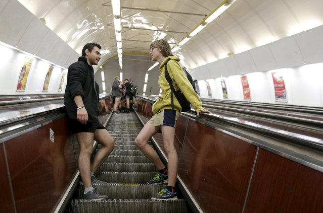 """Passengers not wearing pants stand on a stairs during the """"No Pants Subway Ride"""" in Prague, Czech Republic, January 10, 2016. (Photo by David W. Cerny/Reuters)"""
