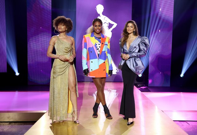 In this image released on April 22, 2021, (L-R) Andra Day, Laverne Cox, and Zendaya speak onstage during ESSENCE Black Women in Hollywood Awards in Los Angeles, California. (Photo by Randy Shropshire/Getty Images for ESSENCE)