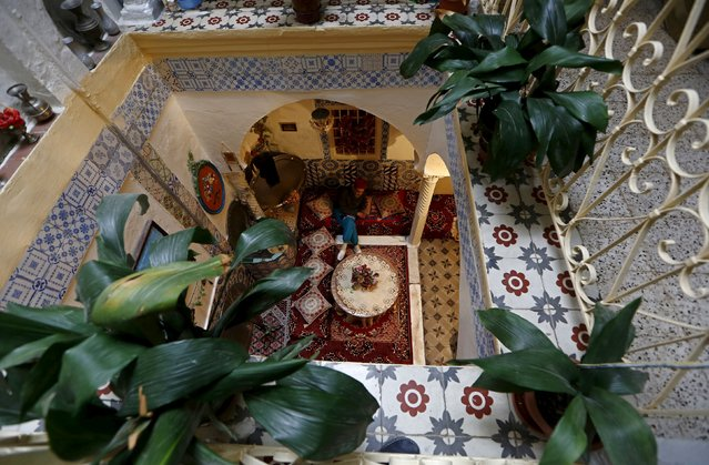 A man sits inside a moorish house in the old city of Algiers Al Casbah, Algeria December 3, 2015. (Photo by Zohra Bensemra/Reuters)