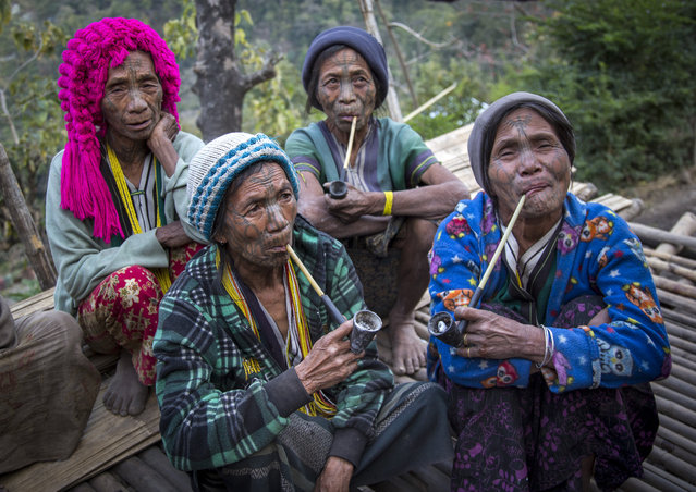 A group of tattooed women from the Muun tribe who inhabit the hills of the Arakan state. The design, known as the letter B-pattern, is common in the Mindat area. It is composed of dots, lines and occasionally circles, in February, 2015, in Myanmar, Burma. (Photo by Eric Lafforgue/Barcroft Media)