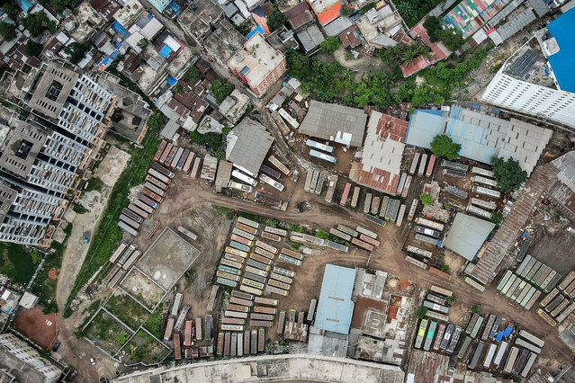 In this aerial photo buses are parked inside a depot after Bangladesh's authorities ordered a new lockdown to contain the spread of Covid-19 coronavirus in Dhaka on June 28, 2021. (Photo by Munir Uz Zaman/AFP Photo)