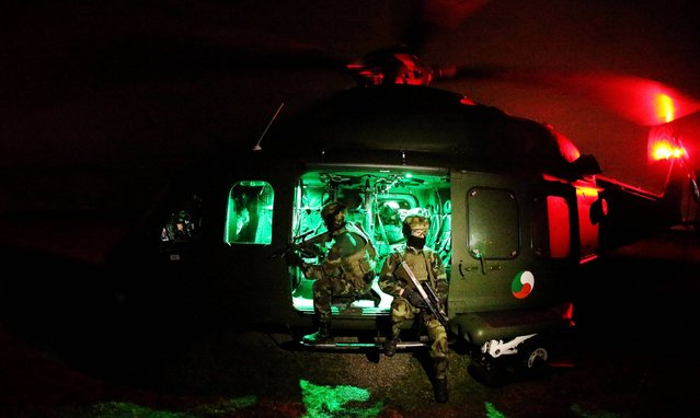 Members of the Army Ranger Wing (ARW) aboard an AW-139 helicopter at the Curragh Camp, Kildare, on November 25, 2013. The Air Corps are celebrating 50 years of helicopter operations. (Photo by Brian Lawless/PA Wire)