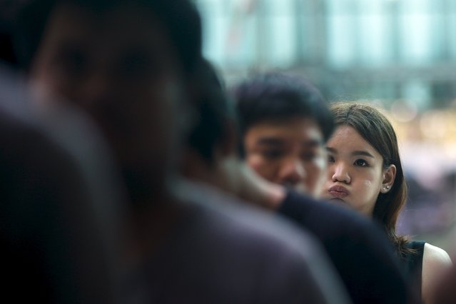 Phiradach, a 21-year-old transgender, queues up during an army draft held at a school in Klong Toey, the dockside slum area in Bangkok April 5, 2015. (Photo by Athit Perawongmetha/Reuters)