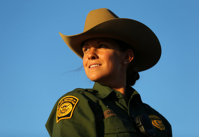 U.S. border patrol agent Katherine Griffith looks out from atop her horse while out on patrol along the U.S.-Mexico border near San Diego, California, U.S., November 10, 2016. (Photo by Mike Blake/Reuters)