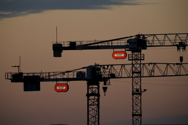 Two cranes with the French construction group Bouygues company logo are seen in the morning sky in Orly, France, near Paris, in this August 1, 2015 file photo. Bouygues is expected to report 2015 results this week. (Photo by Stephane Mahe/Reuters)