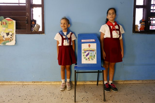 School girls stand next to a ballot box at a polling station in Havana April 19, 2015. (Photo by Reuters/Stringer)
