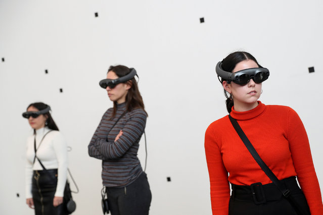 """Attendees look through augmented reality glasses at Marina Abramovic's exhibition """"The Life"""", the world's first large-scale performance exhibited using Mixed Reality at the Serpentine Gallery in London, Britain on February 18, 2019. (Photo by Simon Dawson/Reuters)"""