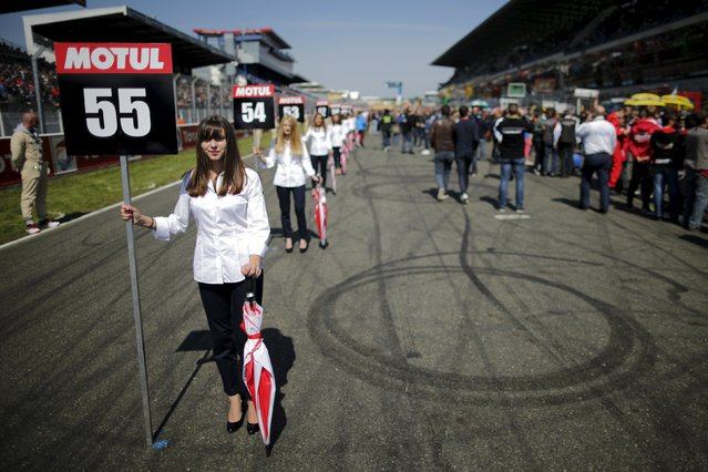 Grid girls are lined up before the 38th Le Mans 24 Hours motorcycling endurance race in Le Mans, western France April 18, 2015. (Photo by Stephane Mahe/Reuters)