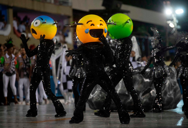 """Members of the """"Grande Rio"""" samba school perform during the first night of Rio's Carnival at the Sambadrome in Rio de Janeiro, Brazil, early on March 4, 2019. (Photo by Mauro Pimentel/AFP Photo)"""