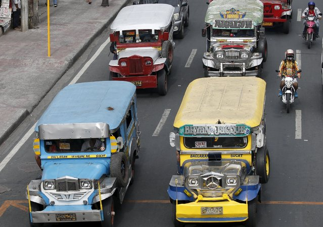 Public transport jeepneys, using diesel fuel, are seen plying on a road in Paranaque, Metro Manila March 2, 2016. (Photo by Erik De Castro/Reuters)