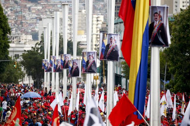 Government supporters listen to Venezuela's President Nicolas Maduro during an anti-imperialist rally for peace, in Caracas, Venezuela, Saturday, March 23, 2019. (Photo by Natacha Pisarenko/AP Photo)
