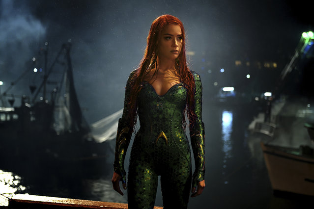 "This image released by Warner Bros. Pictures shows Amber Heard in a scene from ""Aquaman"". (Photo by Warner Bros. Pictures via AP Photo)"
