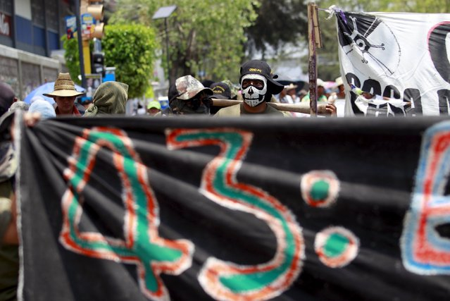 Masked protesters take part in a march for Labour Day in Chilpancingo, Mexico May 1, 2015. (Photo by Daniel Becerril/Reuters)