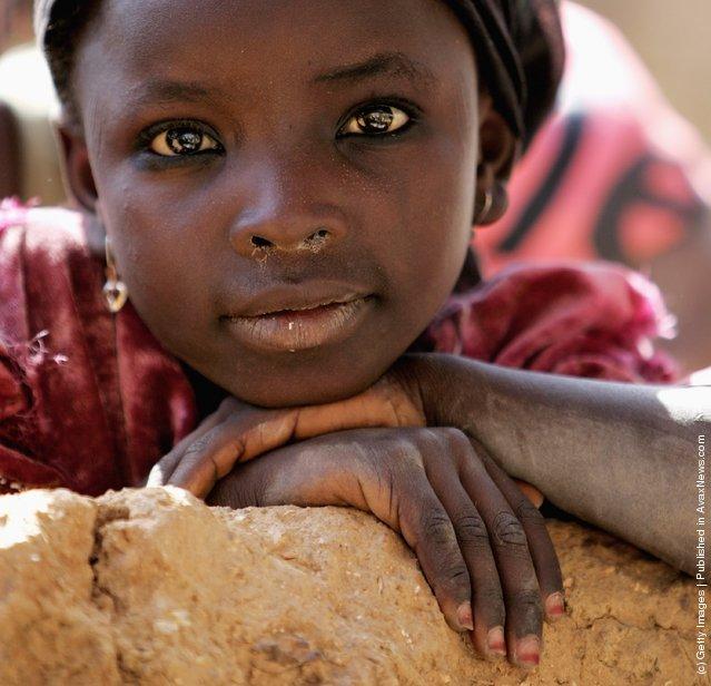 A local girl poses for the camera in Dawakin Kudu village on November 29, 2006 near Freetown, Sierra Leone