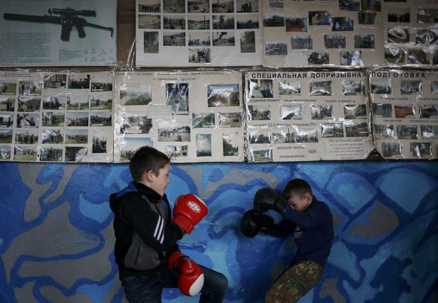 Boys spar during military training undergone by students of the General Yermolov Cadet School and members of a local youth military patriotic club at a boot camp of the Russkiye Vityazi (Russian Knights) military patriotic club in the village of Sengileyevskoye outside Stavropol, Russia, November 2, 2016. (Photo by Eduard Korniyenko/Reuters)