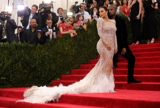 """Kim Kardashian, left, and Kanye West arrive at The Metropolitan Museum of Art's Costume Institute benefit gala celebrating """"China: Through the Looking Glass"""" on Monday, May 4, 2015, in New York. (Photo by Charles Sykes/Invision/AP Photo)"""
