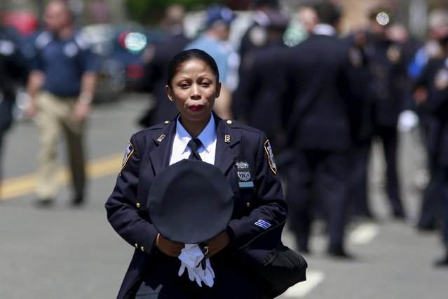 A NYPD police officer arrives for the wake of officer Brian Moore at the Fredrick J. Chapey and Sons Funeral Home in Bethpage, New York, May 7, 2015. The New York City plainclothes police officer who was shot in the head died on Monday, the fifth officer gunned down in as many months amid anti-law enforcement sentiment not seen since the turbulent 1960s, Police Commissioner Bill Bratton said. (Photo by Shannon Stapleton/Reuters)
