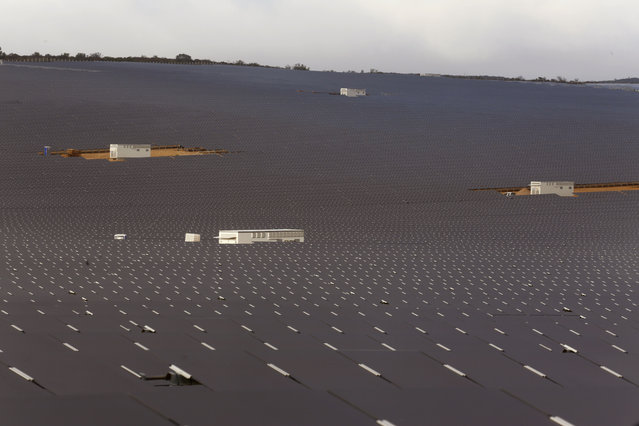 A photovoltaic solar park situated on the outskirts of the coastal town of Lamberts Bay, South Africa, Tuesday, March. 29, 2016. Italian company TerniEnergia, started the solar park making use of a photovoltaic process that converts light into electricity through panels, with the facility expected to produce up to 75 Megawatts, to be connected to the South African electric grid. (Photo by Schalk van Zuydam/AP Photo)
