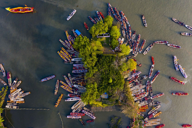 Performers on boats take part in the Qintong Boat Festival at Qin Lake National Wetland Park on April 6, 2019 in Taizhou, Jiangsu Province of China. The boat festival is held around the Qingming Festival every year, and up to 10,000 participants from nearby villages and towns, with more than 500 boats, took part in the event this year. (Photo by Tang Dehong/VCG via Getty Images)