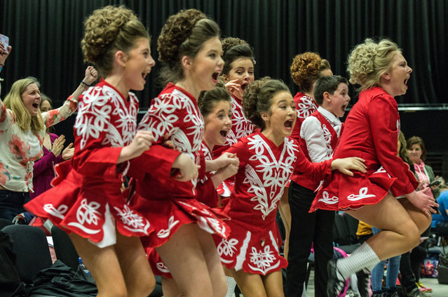 "A team of Irish dancers celebrate after winning the under 12's group kaylee World Irish Dance Championship on April 2, 2016 in Brighton, England. The 8th World and 11th European Irish Dance Championships sees over 1500 dancers from 26 countries, speaking over 20 languages, competing in a variety of contests at the Brighton Centre on the city's beachfront. The event is organised by the World Irish Dance Association and is billed as the ""Irish Dance Spectacular"". (Photo by Chris Ratcliffe/Getty Images)"