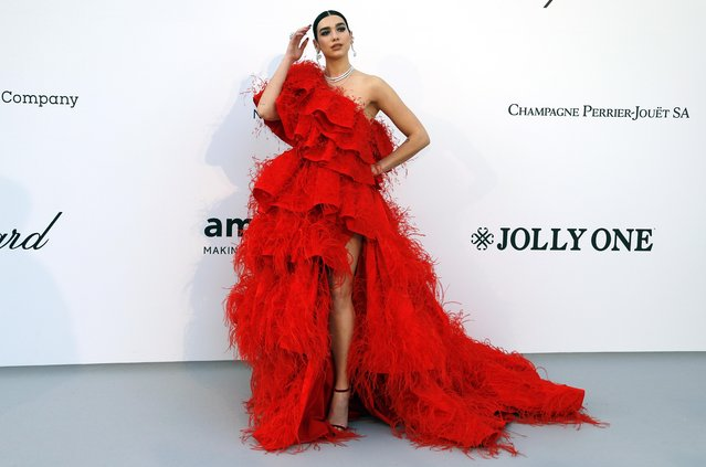 Dua Lipa poses for photographers upon arrival at the amfAR, Cinema Against AIDS, benefit at the Hotel du Cap-Eden-Roc, during the 72nd international Cannes film festival, in Cap d'Antibes, southern France, Thursday, May 23, 2019. (Photo by Eric Gaillard/Reuters)