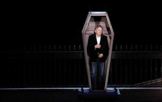 "Polish-French film director Roman Polanski stands in a coffin as he takes part in the presentation of the musical ""Le Bal des Vampires"" (Dance of the Vampires) at the Mogador theater in Paris March 17, 2014. (Photo by Jacky Naegelen/Reuters)"
