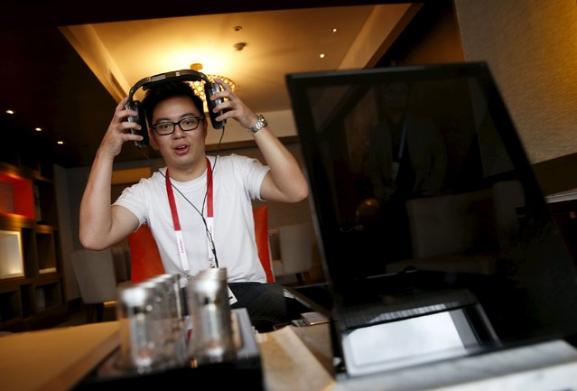An invited guest enjoys a private listening experience of a test unit of the Sennheiser HE 1 sound system, which is expected to retail for about S$77370 ($55000), in a hotel suite during the CanJam headphone and personal audio expo in Singapore February 21, 2016. (Photo by Edgar Su/Reuters)