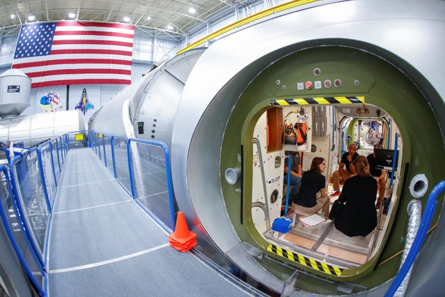 NASA commercial crew astronauts Michael Hopkins and Victor Glover run through a training session at a replica International Space Station (ISS) at the Johnson Space Center in Houston, Texas, U.S., May 22, 2019. (Photo by Mike Blake/Reuters)