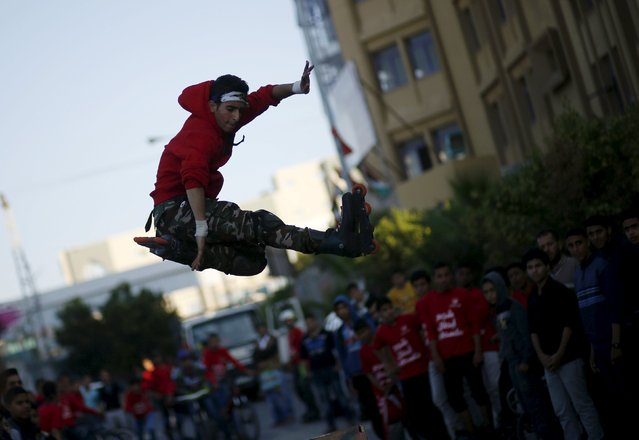 A Palestinian performs stunts during a cultural carnival organized by Gaza Municipality in Gaza City April 1, 2016. (Photo by Mohammed Salem/Reuters)