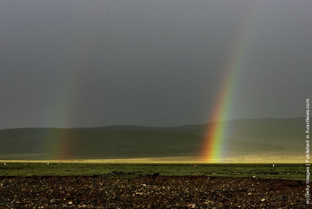 A rainbow appears at the Tanggula Mountain on June 30, 2006 in Tanggula Mountain of Qinghai Province, China