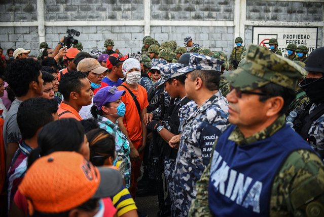 Relatives of injured or missing workers stand in front of Mexican Marines blocking the access to Mexican national oil company Pemex's Pajaritos petrochemical complex in Coatzacoalcos, Veracruz state, Mexico, April 21, 2016. (Photo by Angel Hernandez/Reuters)