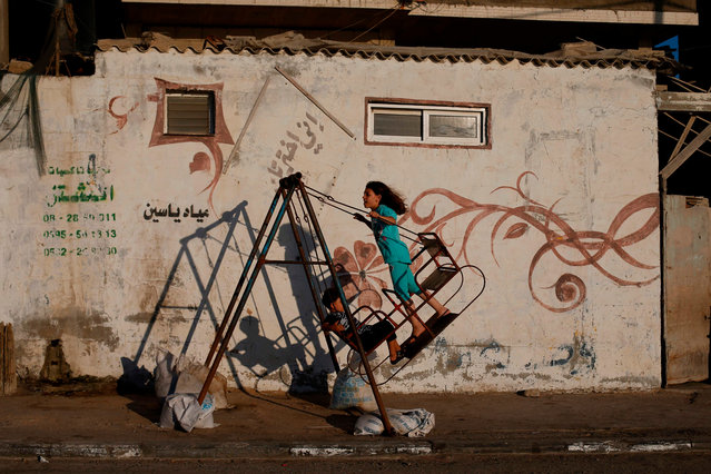Palestinian children play on a swing at Al-Shatee Refugee Camp in Gaza City on July 3, 2019. (Photo by Mohammed Abed/AFP Photo)